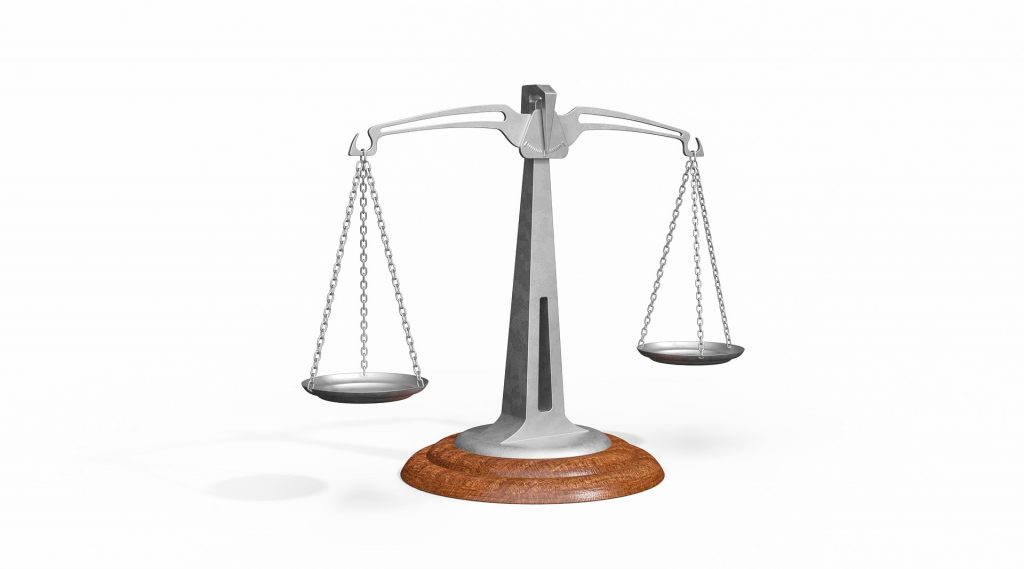 Balance scale symbolizing how to measure success
